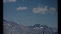 1973: tourists pause on a mountain overlook to view across a valley as afternoon Stock Footage