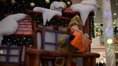 Christmas elf with a gift near the house. Stock Footage