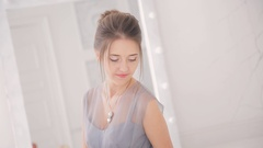 Woman in beautiful dress participate in photo shoot inside apartment Stock Footage