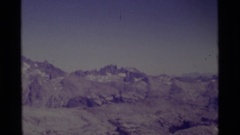 1975: a large area with lots of grass and a mountain around MINARET WILDERNESS Stock Footage