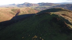 Reverse aerial view over the Shropshire Hills, UK. Stock Footage