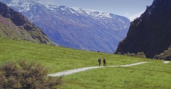Aerial of hikers on a trail, mt aspiring national park, New Zealand Stock Footage