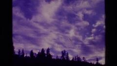 1973: awesome purple sky wispy white clouds SCAPEGOAT WILDERNESS MONTANA Stock Footage