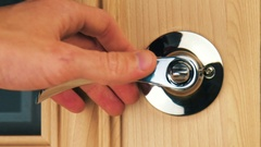 Close-up of the opening of interior wooden door with a metal handle Stock Footage