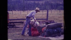 1973: shifting of the big travel bags SCAPEGOAT WILDERNESS MONTANA Stock Footage