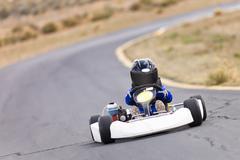 Youth Go-Kart Racer on Track Stock Photos