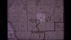 1973: parts of a map are presented highlighting the positioning of forests Stock Footage