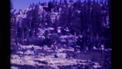 1975: backpackers camping in the wilderness surrounded by granite outcrops Stock Footage