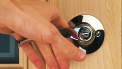 Close-up of the opening of interior wooden door with a metal handle. 3840x2.. Stock Footage