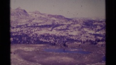 1975: a small serene lake which is nestled in the mountains MINARET WILDERNESS Stock Footage