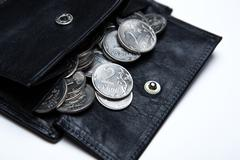 Pocket purse with ruble coins on a white surface Stock Photos