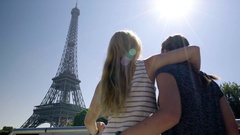Excited Young Women Hug When They See Eiffel Tower From Their Tour Boat Stock Footage