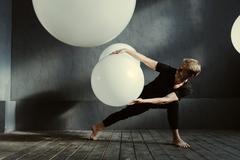 Hypnotic dancer acting in the decorated studio Stock Photos