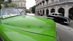 Bright green Chevrolet Bel Air vintage convertible car at the parking. Havana Stock Footage