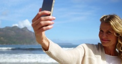 Mature woman taking a selfie from mobile phone Stock Footage