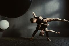 Flexible ballet dancers showing their skills Stock Photos