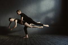 Skilled proficient ballet dancers demonstrating their flexibility Stock Photos