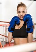 Athletic female boxer starting training Stock Photos