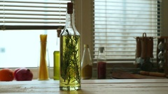 Olive oil bottle on wooden table. Extra virgin olive oil with rosemary herb Stock Footage