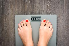 Lose weight concept with person on a scale measuring kilograms Stock Photos