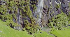 Aerial of waterfall coming from a cliff, wanaka, New Zealand Stock Footage