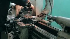 Mechanic using industrial lathe machine Stock Footage