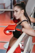 Daring fearless woman standing in ring Stock Photos