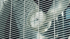 Close up of the outdoor unit of the air conditioner turned on and off. The .. Stock Footage