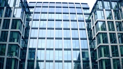 360 degree panoramic shot of surrounding modern glass facade business center. 4K Stock Footage