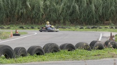 People driving karts on a kart track Stock Footage