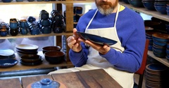 Male potter examining a earthenware bowl Stock Footage
