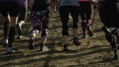 Athletes running an adventure race close up on feet Stock Footage