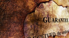 Guarantee text on paper hole grunge concept Stock Footage