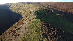 Low fast aerial view over the Shropshire Hills, UK. Stock Footage