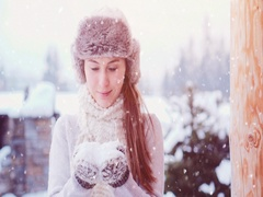 Woman Blowing Snow near Winter Mountain Cottage, SLOW MOTION 120fps 4K DCi. Stock Footage
