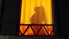 Silhouette shadow of woman undressing in bedroom, view from outside the house Stock Footage
