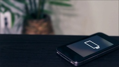 Phone on desk with low battery screen blinking Stock Footage