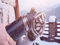 Hands in Mittens pouring Steaming Tea to Cup from Thermos, Winter. 4K SLOW-MO Stock Footage