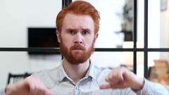 Thumbs Down by Beard Man Stock Footage