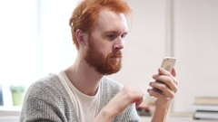 Using Smartphone for Online Browsing, Man with Red Hairs Stock Footage