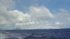View of rainbow against blue sky with clouds in Indian Ocean, Mauritius Island Arkistovideo