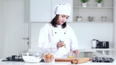 Female chef whisking egg on a bowl Stock Footage