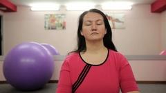 Girl meditates on the yoga class Stock Footage