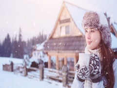 Woman with Cup of Hot Drink by the Cozy Cottage in Winter. 4K SLOW MOTION 120fps Stock Footage
