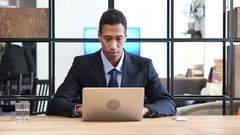 Black Businessman Upset by Loss while Working Online Stock Footage