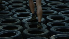 Fitness race - running through tires in slow motion Stock Footage