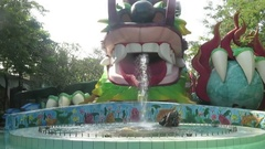 Dragon head shaped fountains in parks in Asia Stock Footage