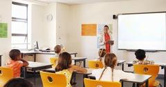 Teacher teaching kids in classroom Stock Footage