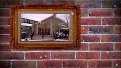 Photo frame a winter snowing footage on brick wall, with snow effect Stock Footage