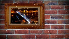 Photo frame of time lapse city night  on brick wall,  with snow effect Stock Footage